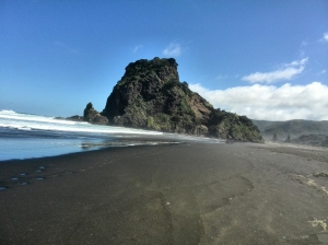 Lion Rock and black sand at Piha Beach, Auckland