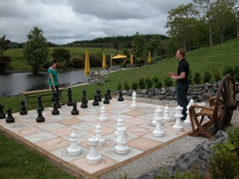 Giant chess set by duck pond